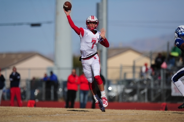 Liberty quarterback Kenyon Oblad passes on a two-point conversion in the second half of the NIAA Division 1 Sunrise Region Football Final prep football game against Basic at Basic High School in H ...