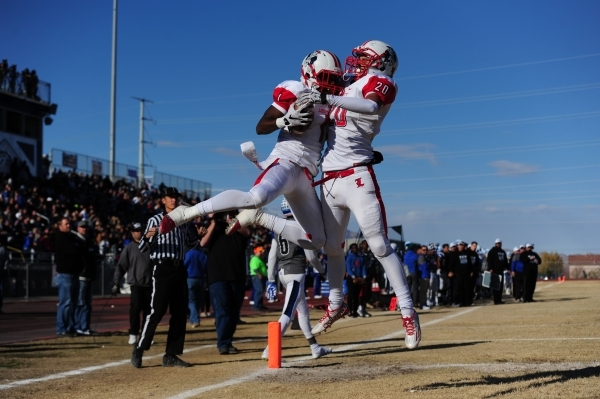 Liberty wide receiver Bryan Roland and tight end Damian Nunez (20) celebrate Nunez's touchdown against Basic in the second half of the NIAA Division 1 Sunrise Region Football Final prep foot ...