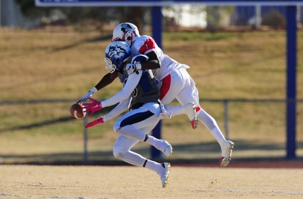 Liberty cornerback Bryan Roland (1) breaks up a pass intended for Basic Wolves wide receiver De'Shawn Eagles in the first half of the NIAA Division 1 Sunrise Region Football Final prep footb ...