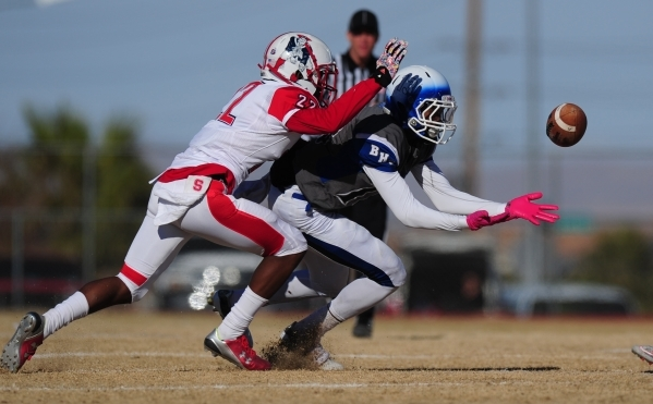 Basic Wolves wide receiver De'Shawn Eagles (13) catches a pass as Liberty cornerback Alan Mwata (22) defends in the second half of the NIAA Division 1 Sunrise Region Football Final prep foot ...