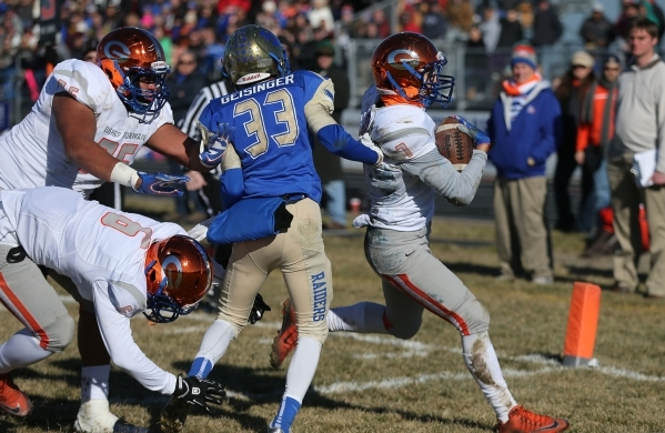 Bishop Gorman's Biaggio Ali Walsh (7) rushes for a touchdown past Reed defender Kyeer Geisinger during an NIAA Division I playoff game at Reed High School in Sparks, Nev., on Saturday, Nov.  ...