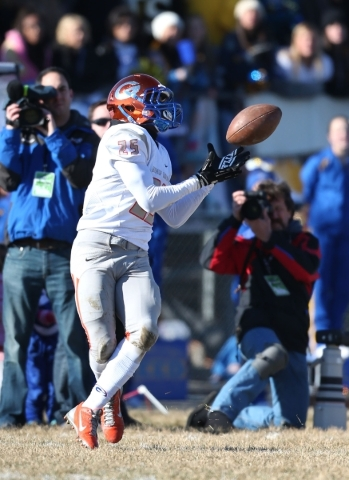 Bishop Gorman's Tyjon Lindsey makes a reception against Reed during an NIAA Division I playoff game at Reed High School in Sparks, Nev., on Saturday, Nov. 28, 2015. Bishop Gorman won 41-13.  ...