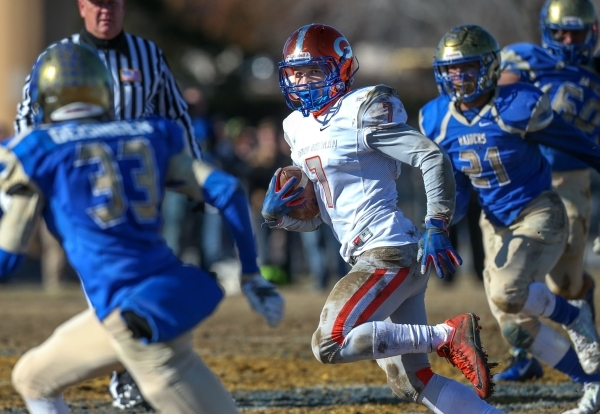 Bishop Gorman's Biaggio Ali Walsh (7) runs against Reed in an NIAA Division I playoff game at Reed High School in Sparks, Nev., on Saturday, Nov. 28, 2015. Bishop Gorman won 41-13. (Cathleen ...