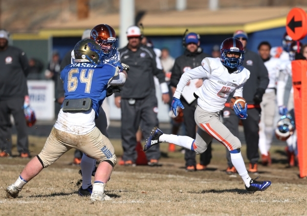 Bishop Gorman's Alex Perry runs an interception back for a touchdown against Reed in an NIAA Division I playoff game at Reed High School in Sparks, Nev., on Saturday, Nov. 28, 2015. Bishop G ...
