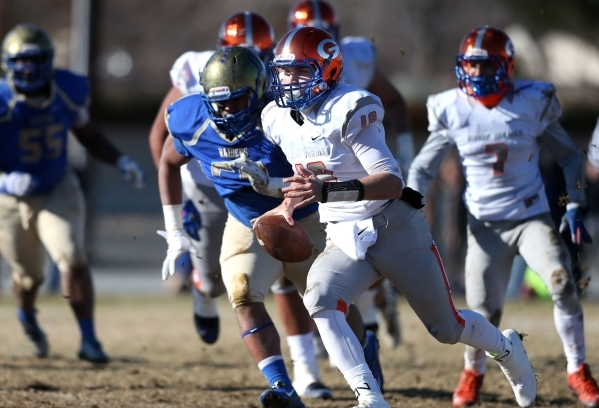 Bishop Gorman quarterback Tate Martell runs against Reed in an NIAA Division I playoff game at Reed High School in Sparks, Nev., on Saturday, Nov. 28, 2015. Bishop Gorman won 41-13. (Cathleen Alli ...