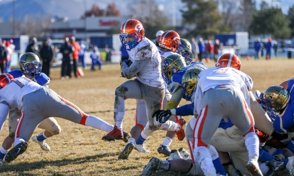 Bishop Gorman's Biaggio Ali Walsh (7) rushes for a touchdown against Reed in an NIAA Division I playoff game at Reed High School in Sparks, Nev., on Saturday, Nov. 28, 2015. Bishop Gorman wo ...