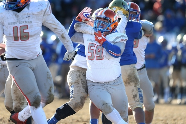 Bishop Gorman's Alfredo Bernall III (59) battles against Reed in an NIAA Division I playoff game at Reed High School in Sparks, Nev., on Saturday, Nov. 28, 2015. Bishop Gorman won 41-13. (Ca ...