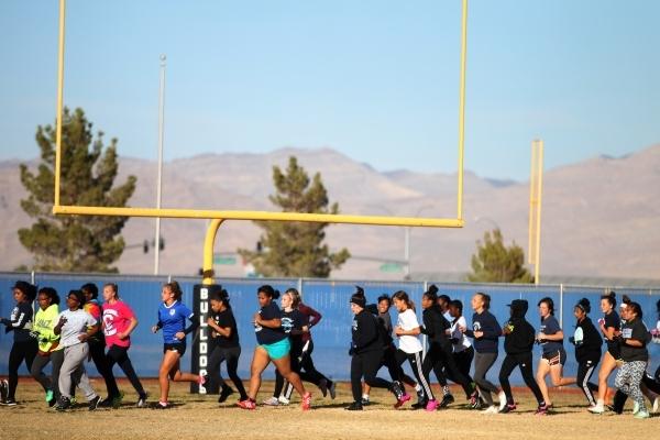 Centennial's girls flag football team runs during a practice at Centennial High School in Las Vegas Tuesday, Nov. 24, 2015. Erik Verduzco/Las Vegas Review-Journal Follow @Erik_Verduzco