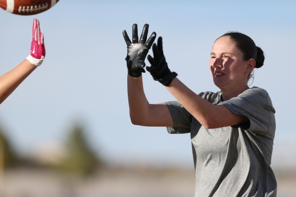 Centennial's Izzy Barilla reaches for a catch during a girl's flag football practice at Centennial High School in Las Vegas Tuesday, Nov. 24, 2015. Erik Verduzco/Las Vegas Review-Journ ...
