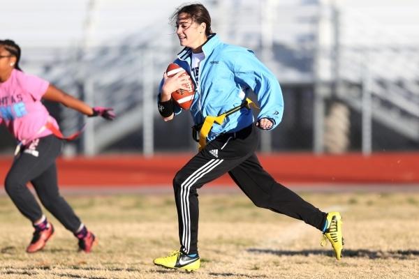 Centennial's Cienna Mendez runs the ball during a girl's flag football practice at Centennial High School in Las Vegas Tuesday, Nov. 24, 2015. Erik Verduzco/Las Vegas Review-Journal Fo ...