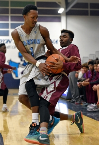Canyon Springs' Derrick Legard, left, and Cimarron-Memorial' Demarco Morris fight for a loose ball during a high school basketball game at Canyon Springs High School on Monday, Nov. 30 ...