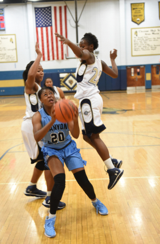 Canyon Springs Alexia Thrower (20) goes up for a layup against Cheyenne's defense during their basketball at the Cheyenne High School gym in North Las Vegas on Wednesday Dec. 2, 2015. Canyon ...