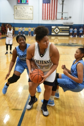 Cheyenne's Koreyl Godbolt (40) goes up for a layup against Canyon Springs defenders during their basketball game at the Cheyenne High School gym in North Las Vegas on Wednesday Dec. 2, 2015. ...