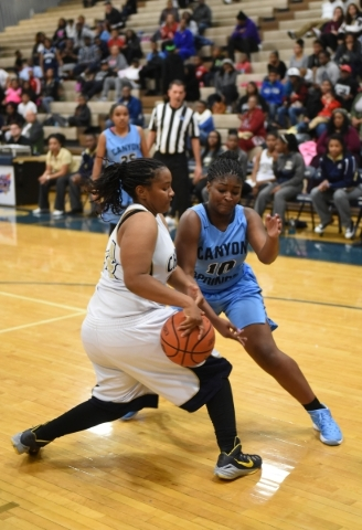 Cheyenne's Alexcia Weatherly (24) and Canyon Springs Destini Hunter (10) fight for a rebound during their basketball game at the Cheyenne High School gym in North Las Vegas on Wednesday Dec. ...