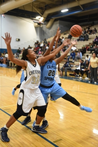 Cheyenne's Da'vione Lomax (32) and Canyon Springs Alexia Thrower (20) fight for a rebound during their basketball game at the Cheyenne High School gym in North Las Vegas on Wednesday D ...
