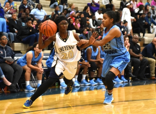 Cheyenne's Kaylah Finley (20) drives by Canyon Springs D'Licya Feaster (25) during their basketball game at the Cheyenne High School gym in North Las Vegas on Wednesday Dec. 2, 2015. C ...