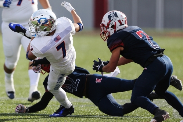 Bishop Gorman's Biaggio Ali Walsh (7) is tackled by Liberty's Alan Mwata (42) in the Division I state championship game at Sam Boys Stadium in Las Vegas Saturday, Dec. 5, 2015. Bishop  ...