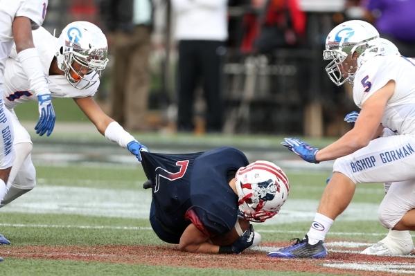 Liberty's Ethan Dedeaux (2) is tackled by Bishop Gorman in the Division I state championship game at Sam Boys Stadium in Las Vegas Saturday, Dec. 5, 2015. Bishop Gorman won 62-21. Erik Verdu ...
