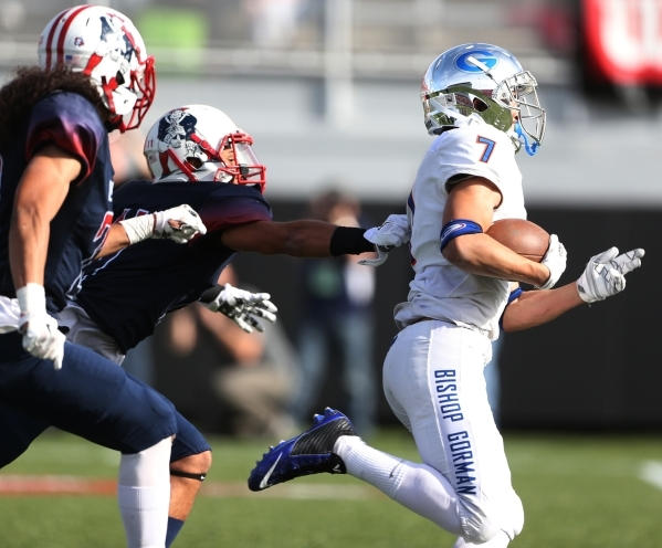 Bishop Gorman's Biaggio Ali Walsh (7) runs the ball for a touchdown against Liberty in the Division I state championship game at Sam Boys Stadium in Las Vegas Saturday, Dec. 5, 2015. Bishop  ...