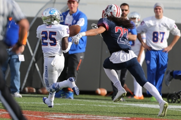 Bishop Gorman's Tyjon Lindsey (25) makes a catch for a touchdown against Liberty in the Division I state championship game at Sam Boys Stadium in Las Vegas Saturday, Dec. 5, 2015. Bishop Gor ...
