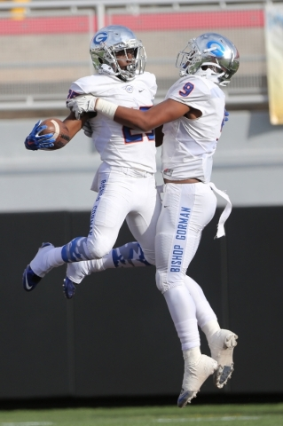 Bishop Gorman's Tyjon Lindsey (25) celebrates his touchdown with Brevin Jordan (9) against Liberty in the Division I state championship game at Sam Boys Stadium in Las Vegas Saturday, Dec. 5 ...