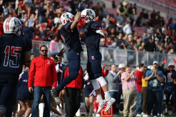 Liberty's Ethan Dedeaux (2) celebrates his touchdown catch with Kenyon Oblad (7) in the Division I state championship game against Bishop Gorman at Sam Boys Stadium in Las Vegas Saturday, De ...