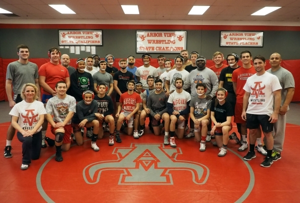 The varsity wrestling team poses for a group photo at Arbor View High School in Las Vegas, Tuesday, Dec. 1, 2015. Wrestler Lawrence Vigil is kneeling third from right. Jerry Henkel/Las Vegas Revie ...