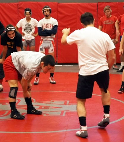 Wrestler Lawrence Vigil, center rear, watches Coach Rusty Marchello, back to camera, demonstrate a move at Arbor View High School in Las Vegas, Tuesday, Dec. 1, 2015. Jerry Henkel/Las Vegas Review ...