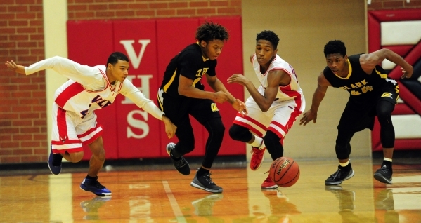 Clark Chargers guard Keyshaun Webb, middle, steals the ball from Valley Vikings guard Shakore Parish, left, while Clark's Darius Jackson (44) and Valley's Roell King look on in the fir ...