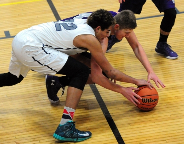 The Meadows School center Max Hisatake (22) fights Spring Creek guard Jake Oliphant for a loose ball during their prep basketball game at Lake Mead Christian Academy in Henderson Friday, Dec. 4, 2 ...