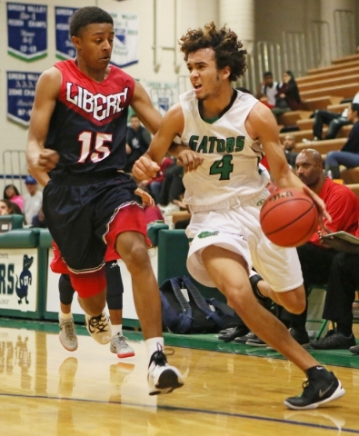 Green Valleyís Xavier Jarvis, right, is defended by Libertyís Cameron Burist during a basketball game at Green Valley Tuesday, Dec. 8, 2015, in Henderson. Green Valley won the game, 84-65. R ...