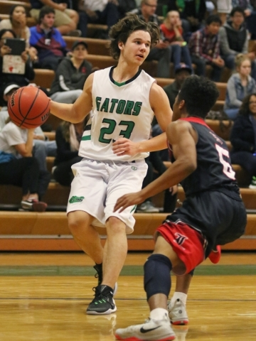 Green Valleyís Matt Tuttle, left, has possession of the ball and is guarded by Libertyís David Bravo during a basketball game at Green Valley Tuesday, Dec. 8, 2015, in Henderson. Green Valle ...