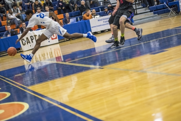 Bishop Gorman guard Christian Popoola Jr. (22) chases a ball while playing against Timpview (Utah) during the first half at Bishop Gorman High School in Las Vegas on Wednesday, Dec. 16, 2015. Josh ...