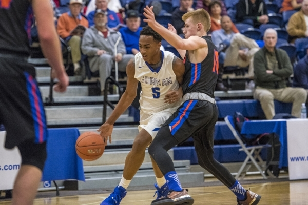 Bishop Gorman guard Chuck O'Bannon (5) drives to the basket past Timpview (Utah) guard Hunter Ericson (10) during the first half at Bishop Gorman High School in Las Vegas on Wednesday, Dec.  ...