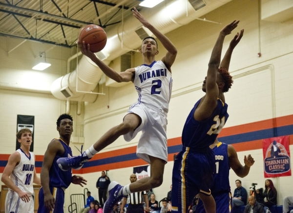 Durango High School's Michael Diggins (2) takes a shot at the net as Lynwood High School's Kieth Carlton (20) defends during the fourth annual Tarkanian Classic basketball tournament a ...