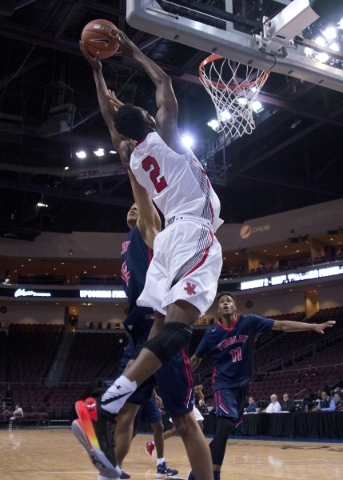 Victory Prep's Jarred Vanderbilt (2) takes the ball to the net during the fourth annual Tarkanian Classic basketball tournament at the Orleans Arena in Las Vegas on Friday, Dec. 18, 2015. Fi ...