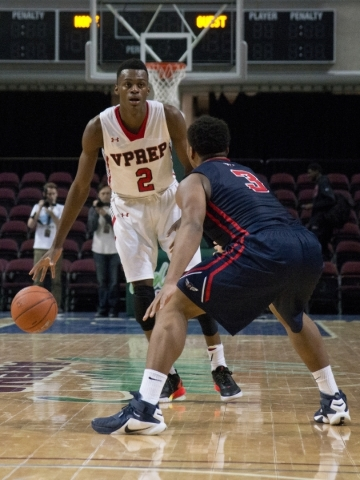 Victory Prep's Jarred Vanderbilt (2) attempts to move the ball past Findlay Prep's Carlos Johnson (3) during the fourth annual Tarkanian Classic basketball tournament at the Orleans Ar ...