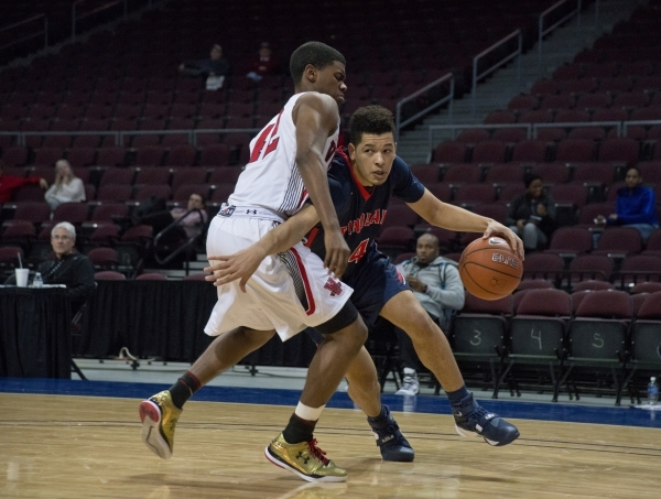 Findlay Prep's Skylar Mays (4) works his way around a Victory Prep player during the fourth annual Tarkanian Classic basketball tournament at the Orleans Arena in Las Vegas on Friday, Dec. 1 ...