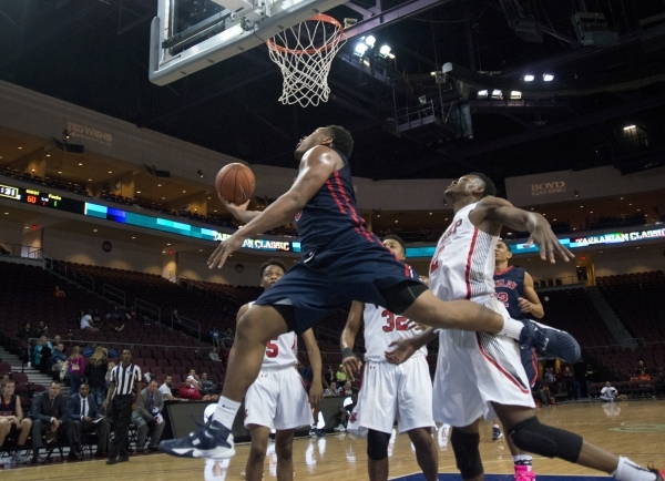 Findlay Prep's Carlos Johnson (3) takes the ball to the net during the fourth annual Tarkanian Classic basketball tournament at the Orleans Arena in Las Vegas on Friday, Dec. 18, 2015. Findl ...