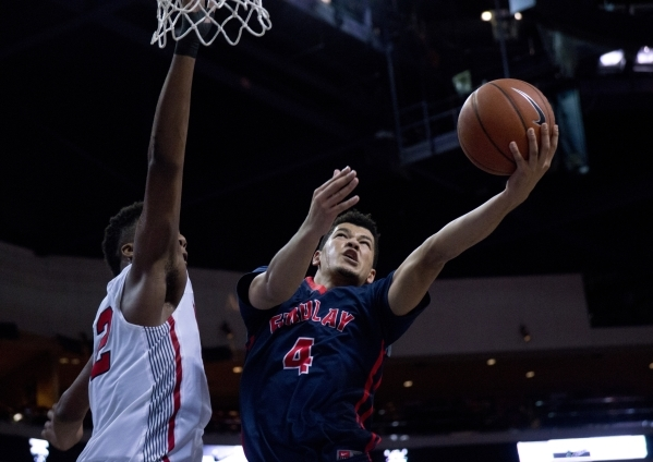 Findlay Prep's Skylar Mays (4) attempts to get the ball past Victory Prep's Jarred Vanderbilt (2) during the fourth annual Tarkanian Classic basketball tournament at the Orleans Arena  ...
