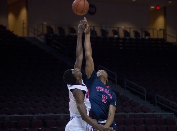 Findlay Prep's PJ Washington (5) and Victory Prep's Jarred Vanderbilt (2) jump for the ball to start their game during the fourth annual Tarkanian Classic basketball tournament at the  ...