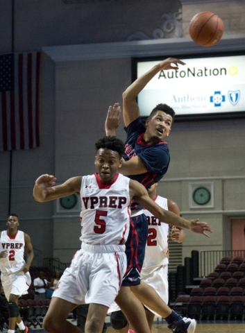 Findlay Prep's Skylar Mays (4) passes the ball after being stopped by Victory Prep's Michael Kimble (5) during the fourth annual Tarkanian Classic basketball tournament at the Orleans  ...