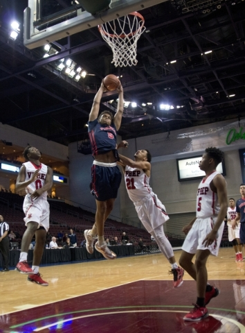 Findlay Prep's PJ Washington (5) takes the ball to the net as Victory Prep's Marvin Powell (21) tries to defend during the fourth annual Tarkanian Classic basketball tournament at the  ...