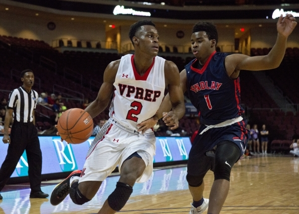 Victory Prep's Jarred Vanderbilt (2) attempts to get around Findlay Prep's Devon Cooper (1) during the fourth annual Tarkanian Classic basketball tournament at the Orleans Arena in Las ...