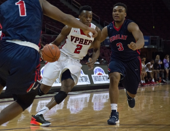 Victory Prep's Jarred Vanderbilt (2) attempts to get around Findlay Prep's Carlos Johnson (3) during the fourth annual Tarkanian Classic basketball tournament at the Orleans Arena in L ...