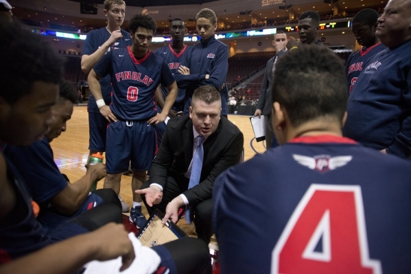 Findlay Prep's head coach Andy Johnson talks to his team during a timeout during the fourth annual Tarkanian Classic basketball tournament at the Orleans Arena in Las Vegas on Friday, Dec. 1 ...