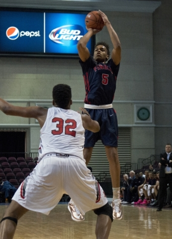 Findlay Prep's PJ Washington (5) makes a three point shot during the fourth annual Tarkanian Classic basketball tournament at the Orleans Arena in Las Vegas on Friday, Dec. 18, 2015. Findlay ...