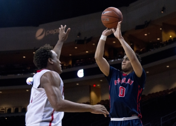 Findlay Prep's Markus Howard (0) attempts to put a three point shot over Victory Prep's John Dockery (1) during the fourth annual Tarkanian Classic basketball tournament at the Orleans ...