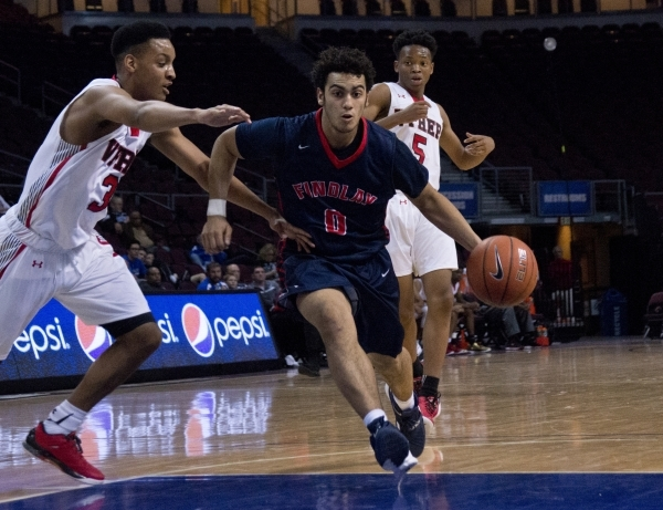 Findlay Prep's Markus Howard (0) moves the ball past Victory Prep's Emery Vanderbilt (3) during the fourth annual Tarkanian Classic basketball tournament at the Orleans Arena in Las Ve ...