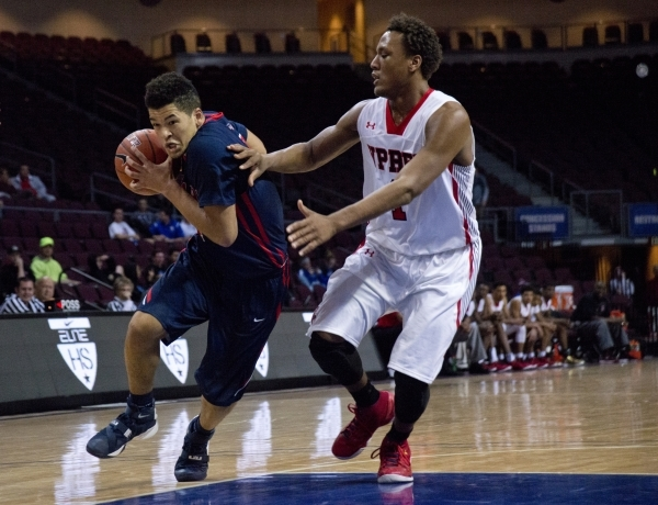 Findlay Prep's Skylar Mays (4) attempts to move the ball past Victory Prep's John Dockery (1) during the fourth annual Tarkanian Classic basketball tournament at the Orleans Arena in L ...